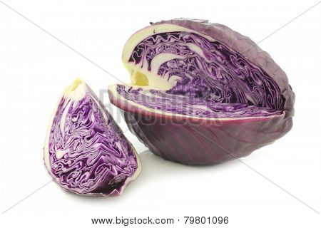 freshly harvested cut red pointed cabbage on a white background