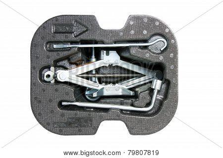 Car Jack And Basic Tool Isolated On White.