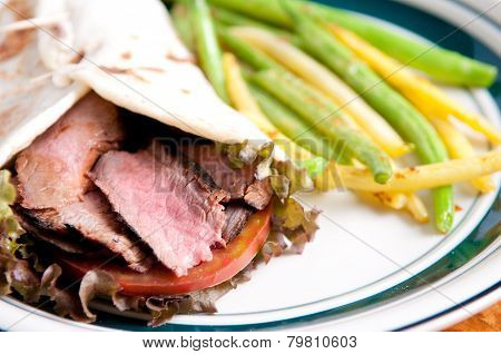 Flank Steak Burrito On Home Made Flatbread With Garlic Fried String Beans