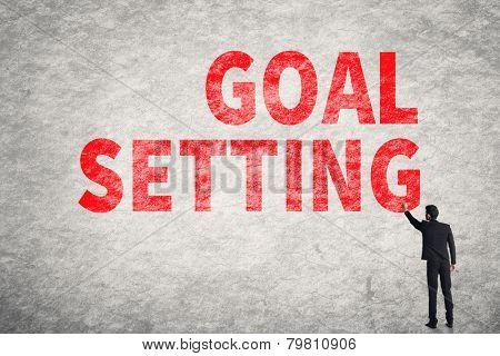 Asian businessman write text on wall, Goal Setting