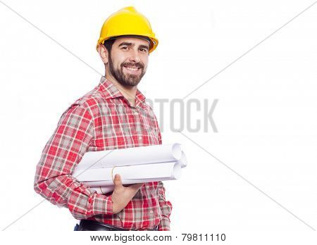 Portrait of smiling young architect holding blueprints on white background