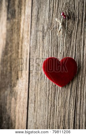 Red Heart Hanging On Wooden Texture Background