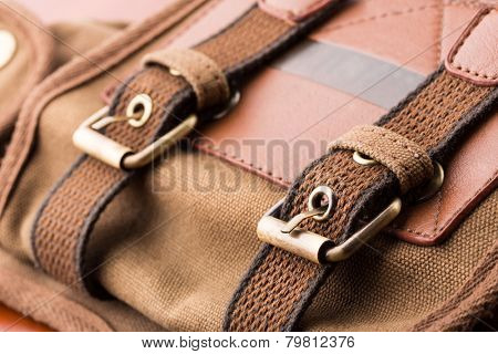 Brown backpack buckle