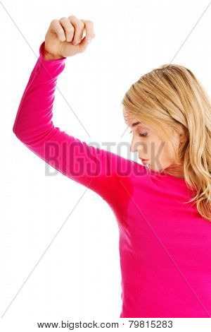 Woman sweating very badly have wet armpit