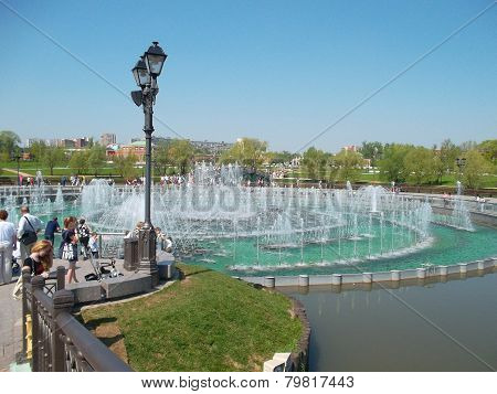 Fountains In The City. Lamp Post. People