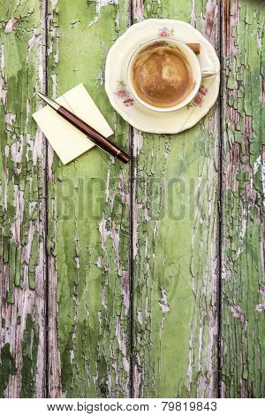 Cup Of Coffee On Cracked Wooden Background
