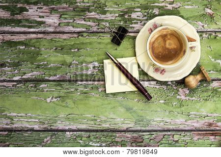 Cup Of Coffee And Pen On Wooden Background