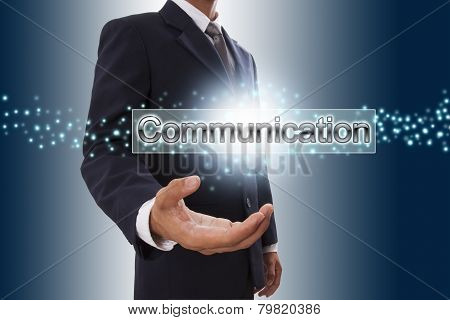 Businessman with communication word button