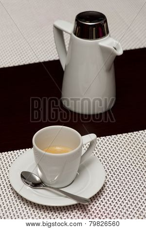White Espresso Cup With Coffee Beside Pot