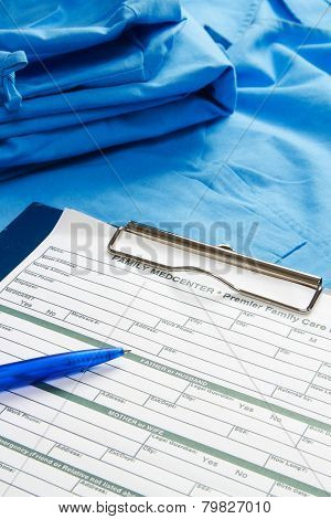RX prescription, pen lying on a medical uniform