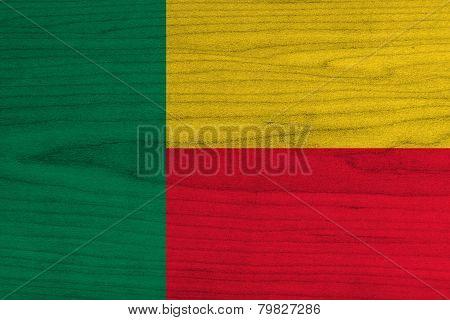 Benin Flag on wood background
