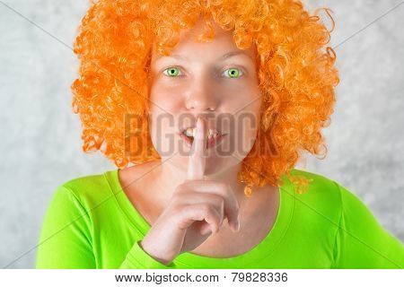 Orange Girl With Finger On Lips