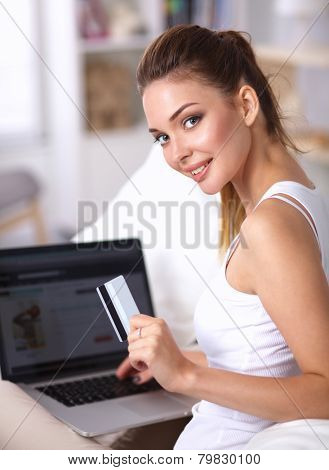 Woman shopping online with credit card and computer.Internet Shopping