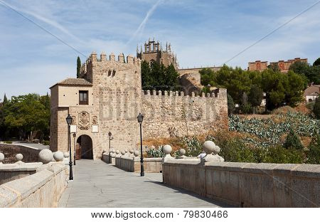 The alcazar above the medieval San Martin bridge - Toledo Spain