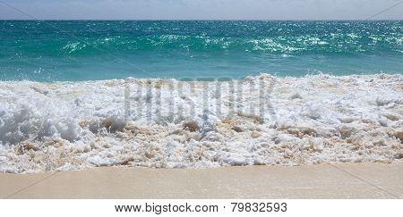 Snow-white foam of the Caribbean Sea. Playa los Cocos. Cayo Larg