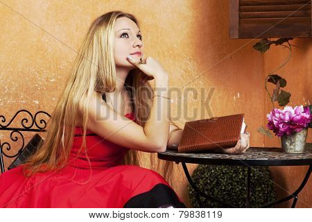 Woman With Notebook