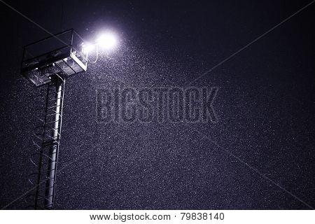 snowfall at night with lantern light