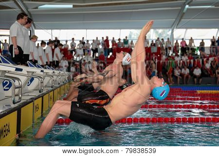 GRAZ, AUSTRIA - APRIL 04, 2014: Robert Zbogar (Slovenia) places 6th in the men's 50m backstroke event in an indoor swimming meeting.
