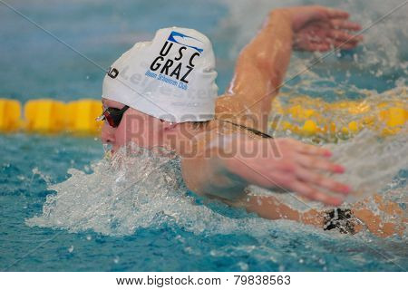 GRAZ, AUSTRIA - APRIL 04, 2014: Caroline Pilhatsch (Austria) places 12th in the women's 100m butterfly event in an indoor swimming meeting.