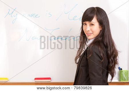 Asian Teacher Writing On Whiteboard
