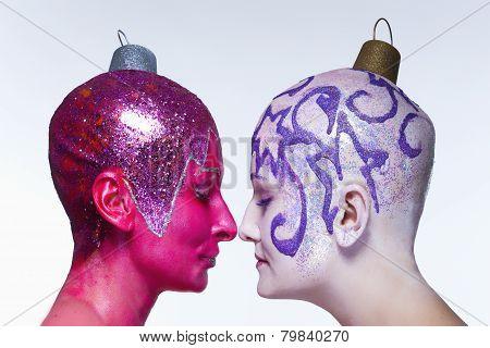 Two Women Posing As Christmas Ornaments
