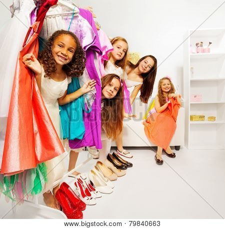 Hiding girls during shopping choose clothes