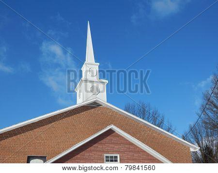 blue sky church steeple