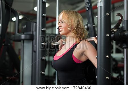 Girl Lifts Weights