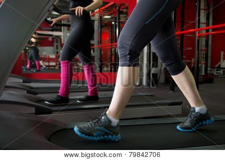 Women Legs In Sneakers On Treadmill