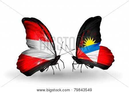 Two Butterflies With Flags On Wings As Symbol Of Relations Austria And Antigua And Barbuda