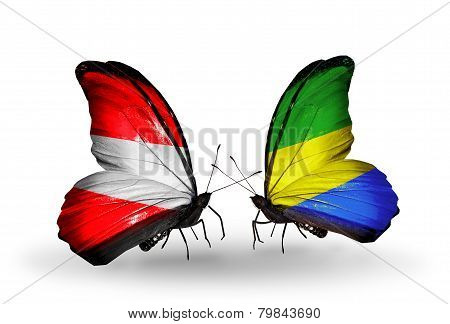 Two Butterflies With Flags On Wings As Symbol Of Relations Austria And Gabon