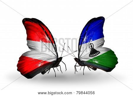Two Butterflies With Flags On Wings As Symbol Of Relations Austria And Lesotho