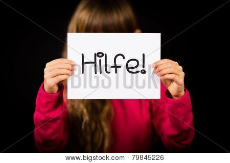 Child Holding Sign With German Word Hilfe - Help