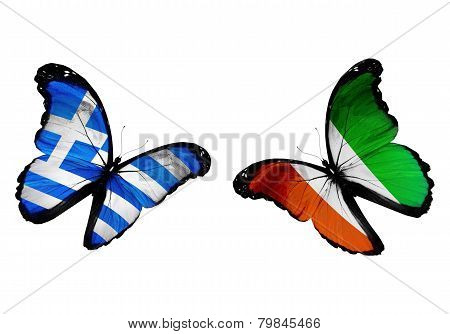 Concept - Two Butterflies With Greece And Cote Divoire Flags Flying, Like Two Football Teams Playing