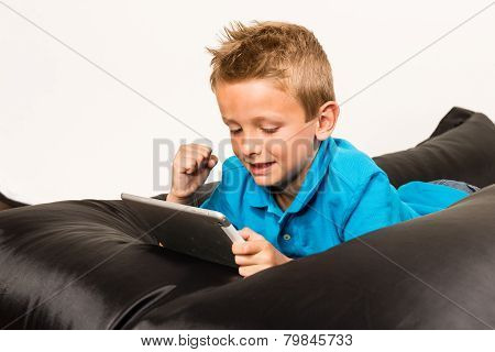 Boy With Tablet And Raised Hand
