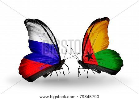 Two Butterflies With Flags On Wings As Symbol Of Relations Russia And Guinea Bissau