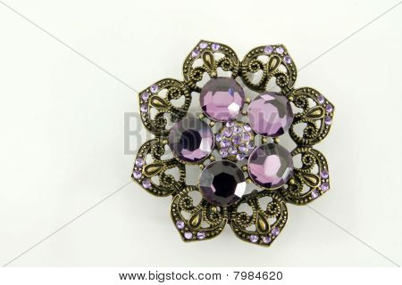 Brooch with purple gems