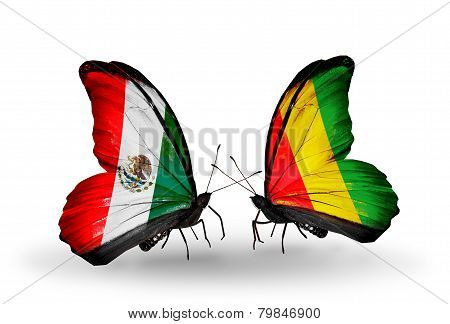 Two Butterflies With Flags On Wings As Symbol Of Relations Mexico And Guinea