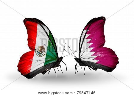 Two Butterflies With Flags On Wings As Symbol Of Relations Mexico And Qatar