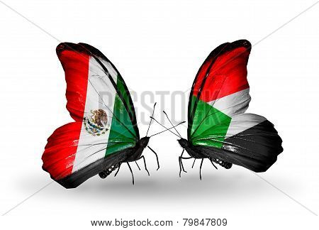 Two Butterflies With Flags On Wings As Symbol Of Relations Mexico And Sudan