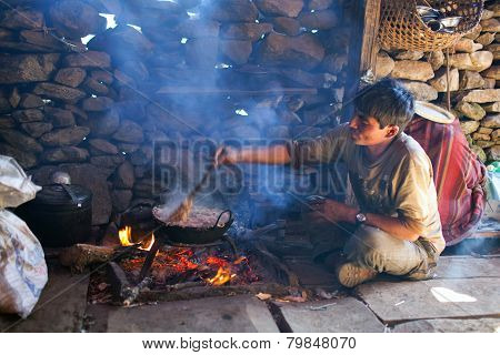 Nepalese Man Cooking