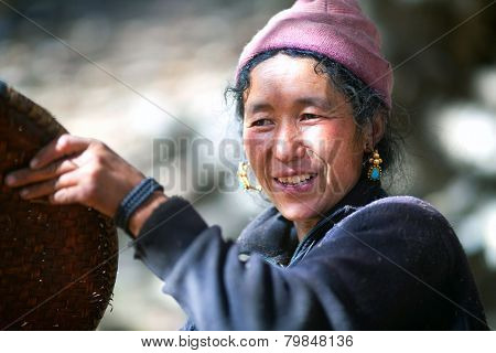Nepalese Peasant Woman With Basket