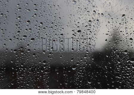 Rain drops on the window glass. Rainy weather.