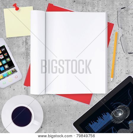 Blank note pad with office and business work elements around