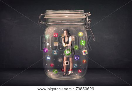 Businesswoman captured in a glass jar with colourful app icons concept on background