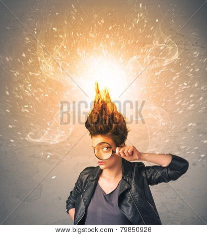 Young woman with energetic exploding red hair concept on background