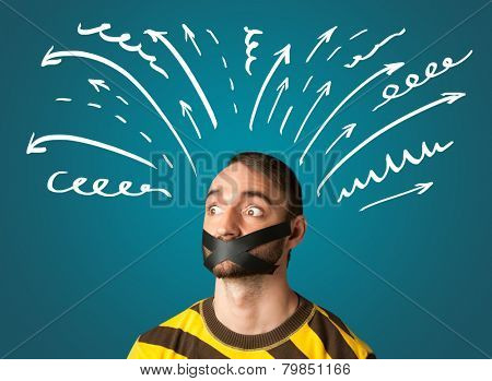 Young man with taped mouth and white drawn lines and arrows around his head