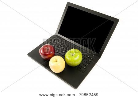 Three Apples On A Laptop