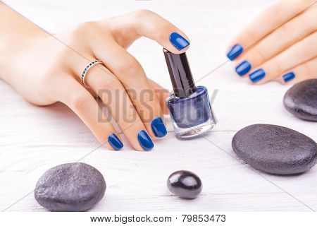 blue manicure with black stones