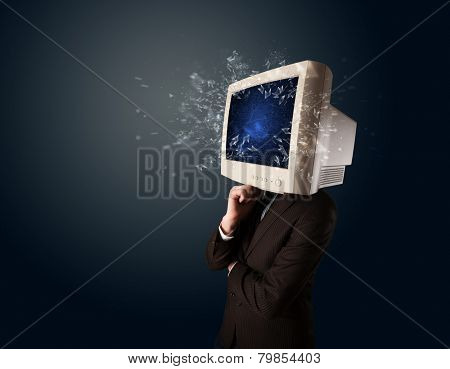 Computer monitor screen exploding on a young persons head concept
